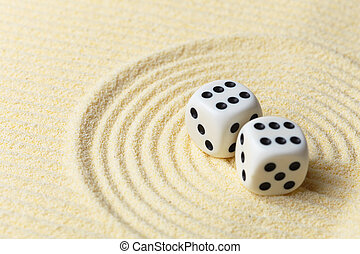 Dices on sand surface - abstract art composition - Dices on...