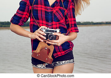 Photographer - Young girl photographer with old film camera...