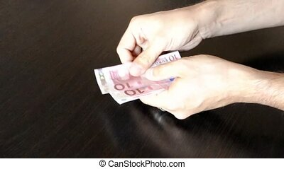 Man hands counting 10%u20AC banknotes - Man hands counting...