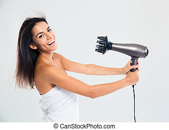 Laughing woman in towel drying her hair isolated on a white...