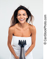 Laughing woman in towel drying her hair - Funny laughing...