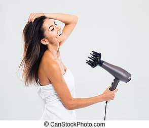 Cheerful woman in towel drying her hair isolated on a white...