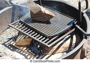 Cooking a large steak on a BBQ - Cooking a large piece of...