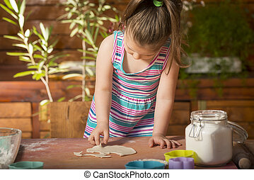 Little girl having fun cooking - Happy little chef smeary...