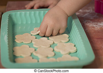 Little girl having fun cooking - Little chef hands smeary...