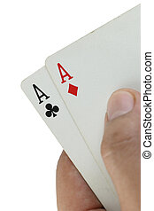 Double A playing cards in hand.