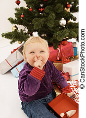 Shhh - Cute baby sneakily opening christmas gifts - Shhh -...