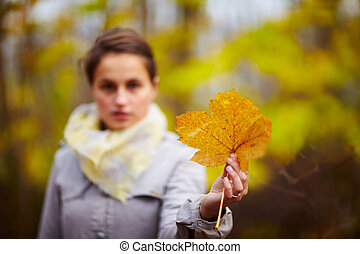 C02 - Think about your ecosystem,woman showing maple leaf