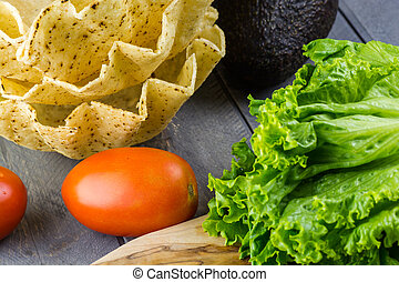Lettuce,vegetables and tostada bowl - Close up of...