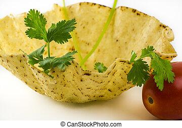 Tostada bowl. - Close up of tostada bowl on a white...