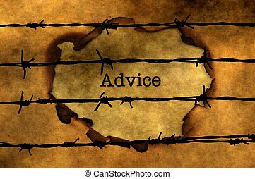 Advice concept against barbwire