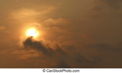 sun appearing from behind clouds - panorama of sun appearing...