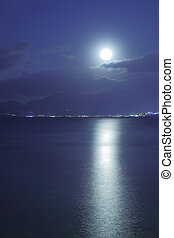 Full moon over sea - Full moon over Mediterranean Sea and...