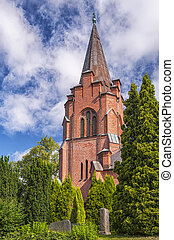 Billinge Kyrka - An image of the red brick church in the...