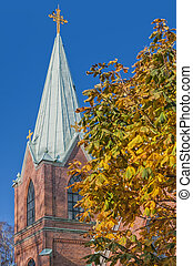 Landskrona Kyrka - An image of a red brick church in the...