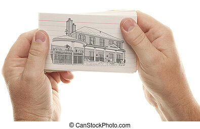 Male Hands Holding Stack of Flash Cards with House Drawing