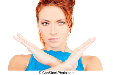 stop - bright picture of young woman making stop gesture