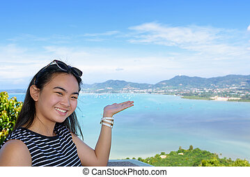Women tourist inviting to see of the sea in Phuket Province, Thailand