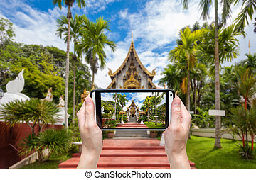 Hand taking photo at wat pha dara bhi rom Temple located in...