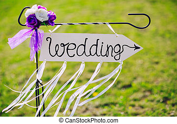 arrow labeled wedding on a green grass