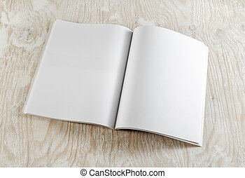 Blank opened book on light wooden background with soft...