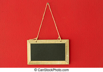 chalkboard on red wall - blank chalkboard hanging on the red...
