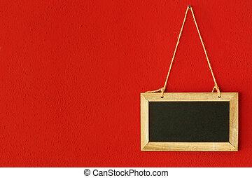 blackboard on red wall