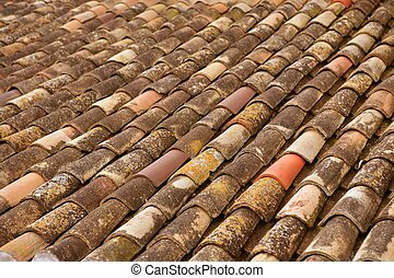 Aged old clay arabic roof tiles in rows