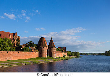 evening Malbork castle - view of famous castle Malbork,...