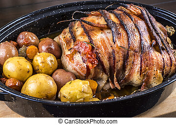 Roasted chicken with bacon and potatoes - Bacon wrapped...
