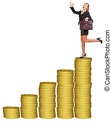 Businesslady with suitcase on gold coins stack -...