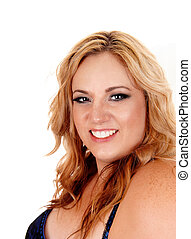 Smiling plus size blond woman. - A plus size blond woman in...