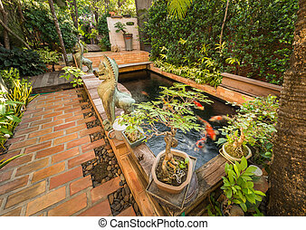 garden and fish pond - view of garden and fish pond