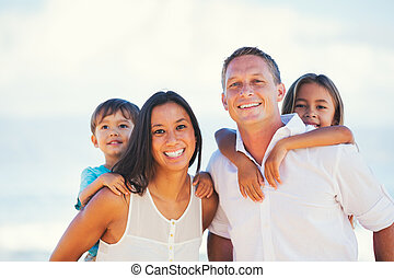 Happy Mixed Race Family Having Fun Outdoors - Portrait of...