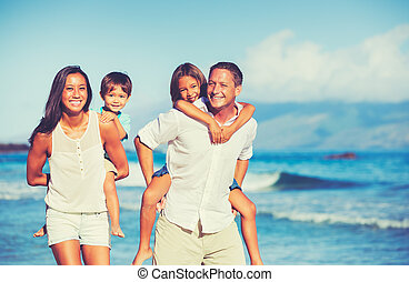 Happy Family Together Having Fun - Young Happy Family Having...