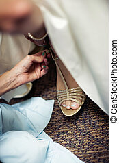 Bridal Shoes - Close up of bridal foot putting her shoes on...
