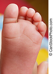 baby foot - a baby foot a over colors background
