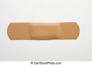 Bandaid - Single bandaid shot on white background with soft...