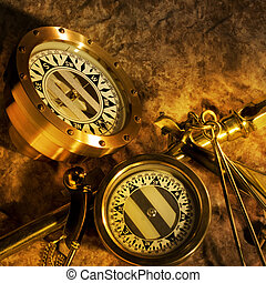 Antique brass compasses - Two antique brass compasses shot...