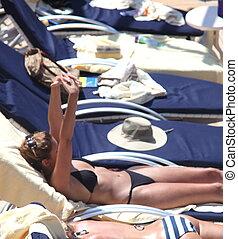 Cruise Vacation. - Women enjoying a suntan on a cruiseship.