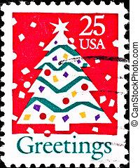 usa postage stamp shows christmas tree, circa 1980\'s - USA...
