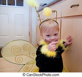 Cute Toddler Girl in Bee Costume - This cute toddler girl is...