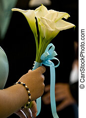 Bridesmaids flowers with the bridesmaid daintily holding...