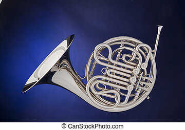 French Horn Silver Isolated On Blue - A professional silver...