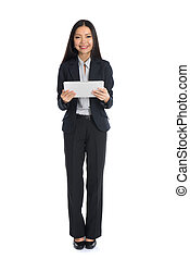 full length business woman smiling using touch pad tablet pc isolated on white background, model is a asian beauty
