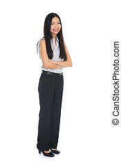 Business woman standing in full length isolated on white background. Beautiful mixed race Chinese female mode in suit.