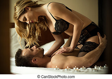 Loving couple having intimate moments in bedroom