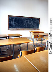 traditional classroom interior with blackboard and desks