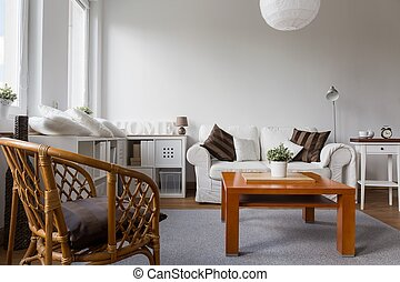 Wicker armchair in living room - Wicker armchair in white...