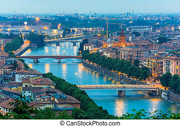 River Adige and bridges in Verona at night, Italy - Verona...
